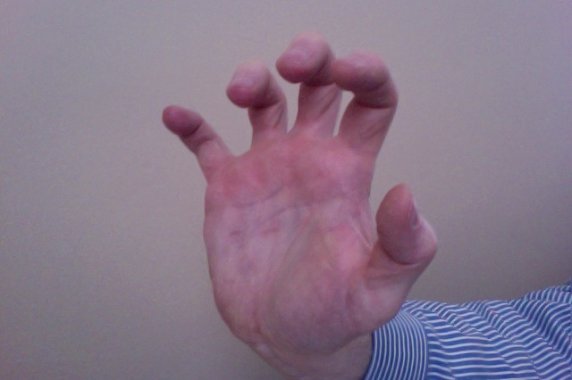 Hand showing tiger claw