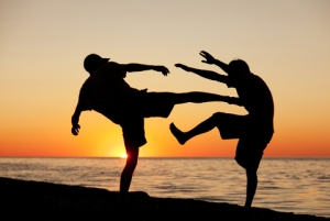 Fight on Beach at Sunset